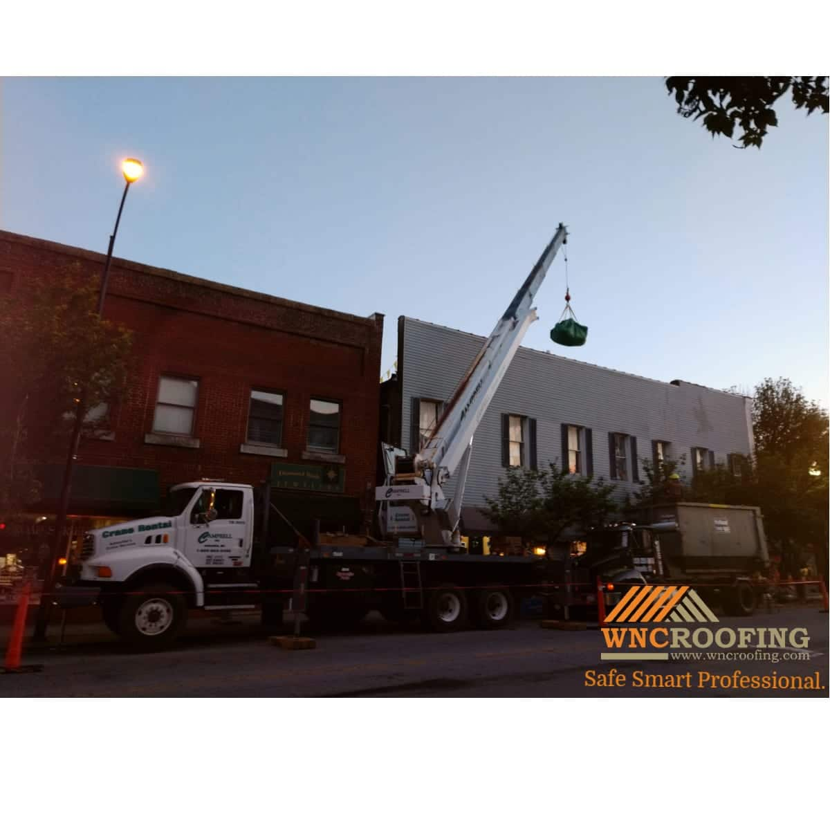 A crane loading material on OP Taylor's roof in Brevard North Carolina