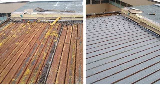 Roof stripped down to wood decking covered with gray primer