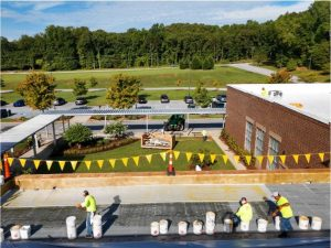 WNC Roofing crew on top of Greenville school adhering tpo membrane