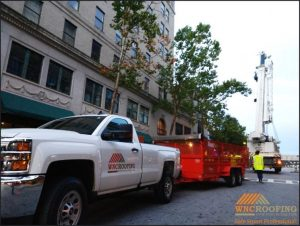 WNC Roofing company pickup truck being unloaded in downtown Asheville, North Carolina