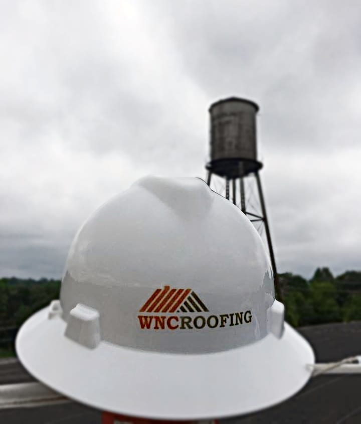 WNC Roofing hard hat with cloudy sky and rain in Greenville, SC