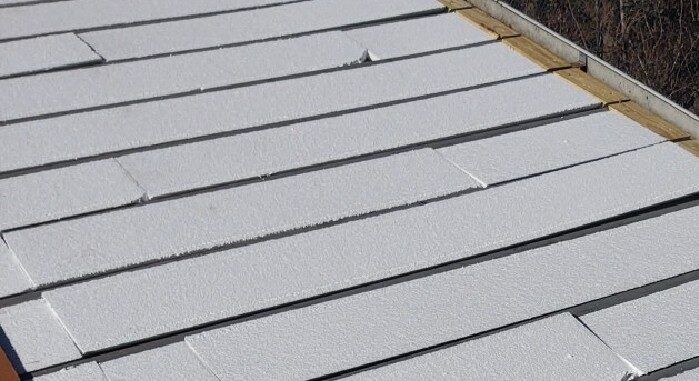 Flute-fill retrofit commercial roofing system